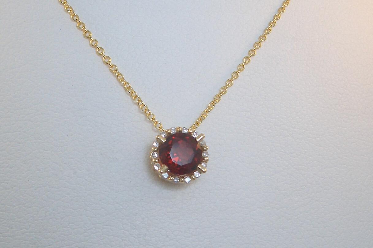 Garnet and Diamond Halo Pendant